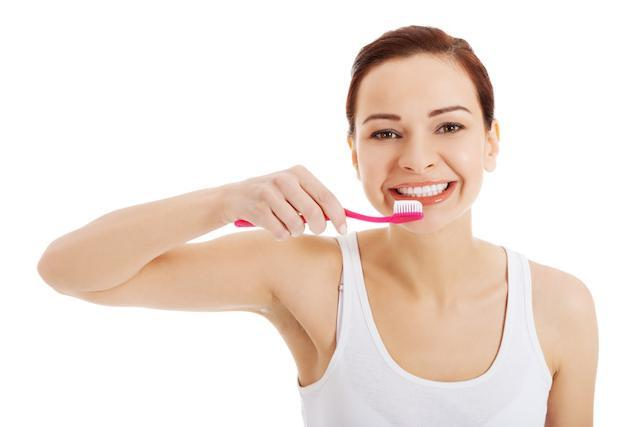 Woman brushing teeth | Dentist Toronto ON