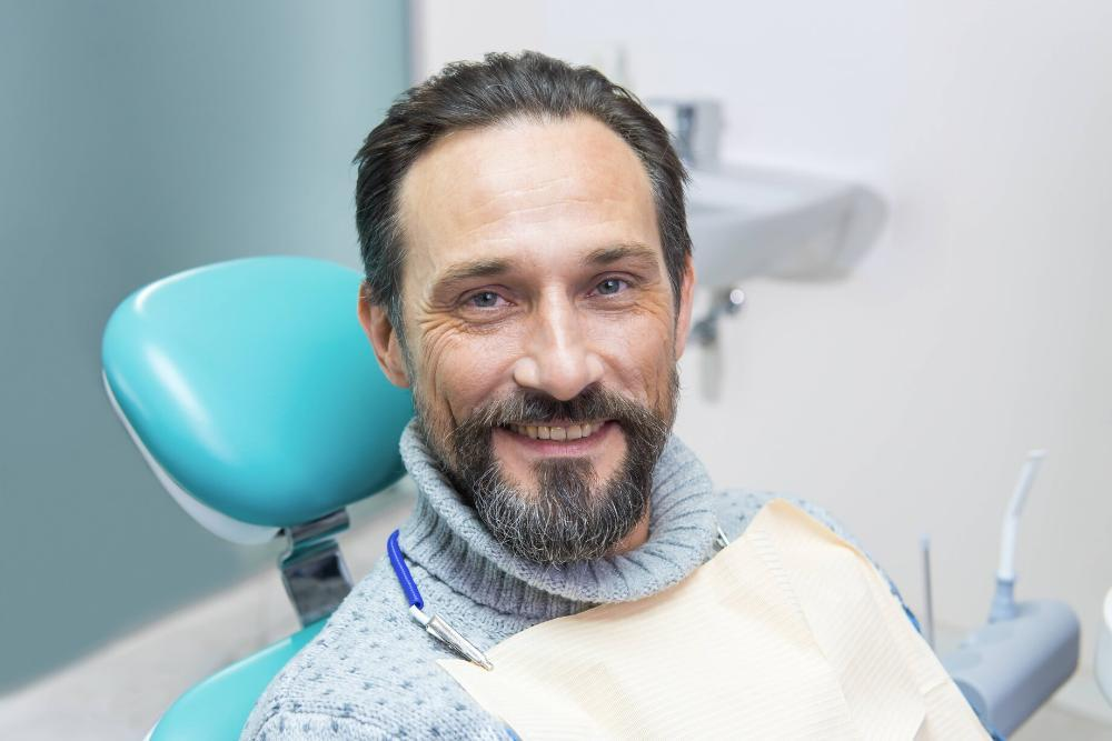 man smiling in dental chair