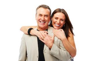 Woman hugging man from behind | Dentist Toronto ON
