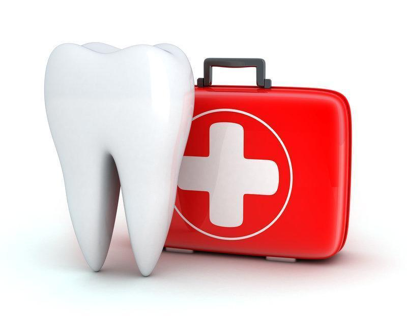 Tooth next to dental emergency kit