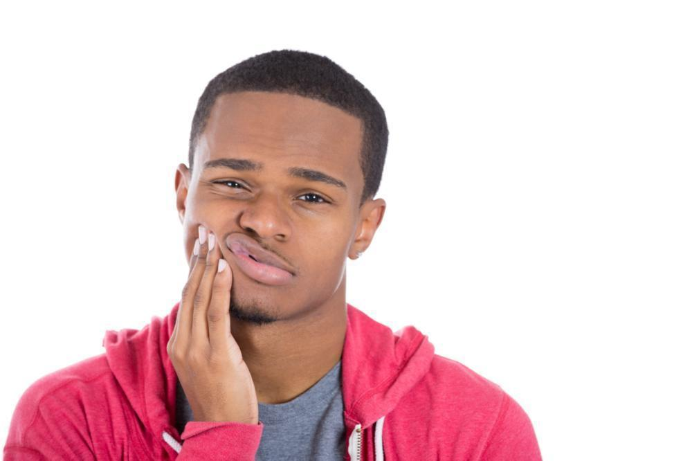 Man holding jaw pain | Dentist Toronto ON