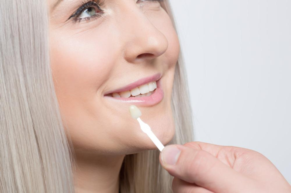 Woman getting dental veneer | Toronto Lakeshore Dental