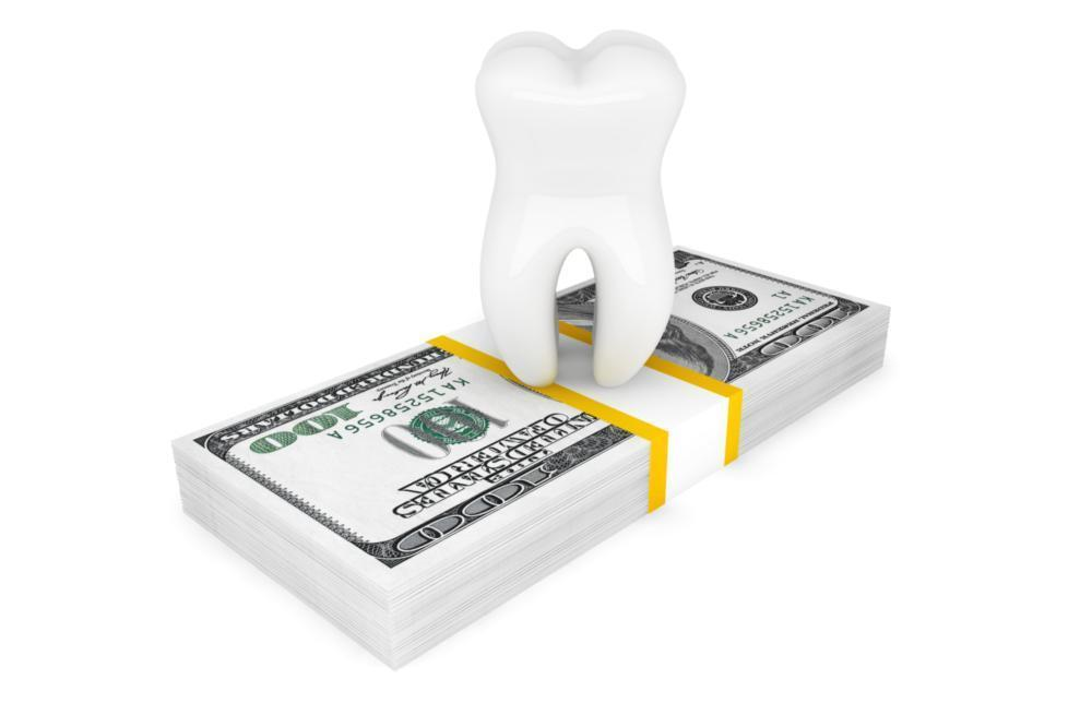tooth on top of cash | Dentist Toronto ON