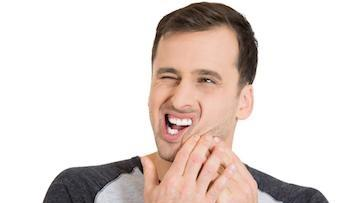 Man With Jaw Pain | Root Canals Toronto ON