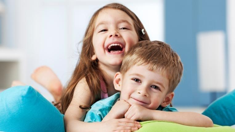 Young boy and girl smiling | Dentist Toronto ON