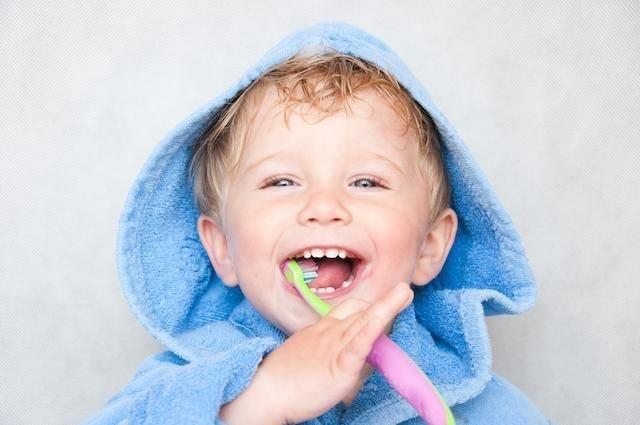Young boy brushing teeth | Dentist Toronto ON