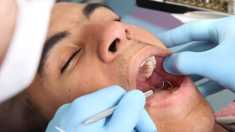 man getting dental check | Dentist Etobicoke ON