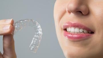 Woman Holding Clear Retainer | Dentist in Etobicoke ON