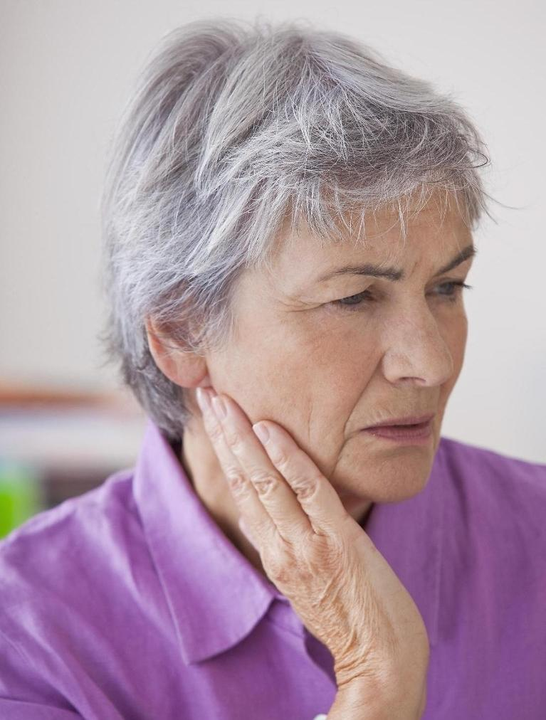 Woman With Jaw Pain | Root Canals Toronto ON