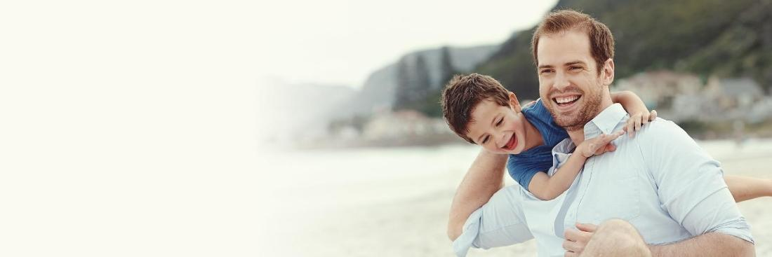 Father and son on beach | Dentist Toronto ON