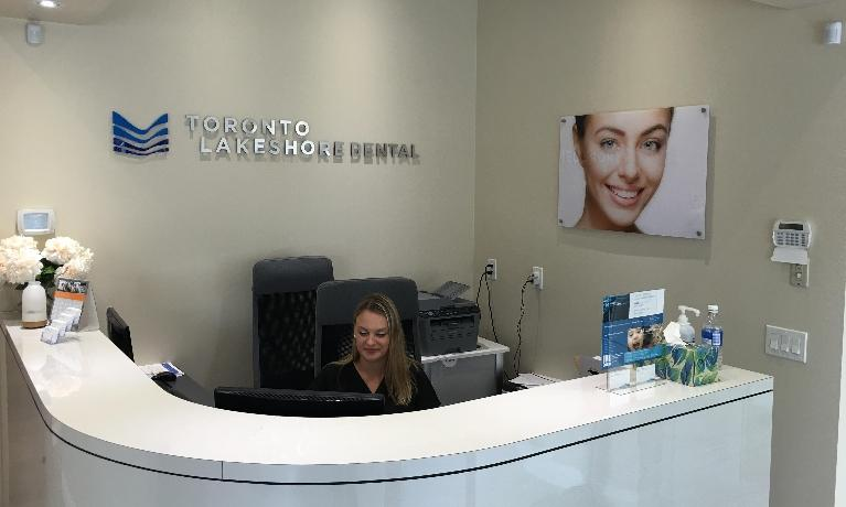 Front Desk with woman sitting at computer | Dentist Toronto ON